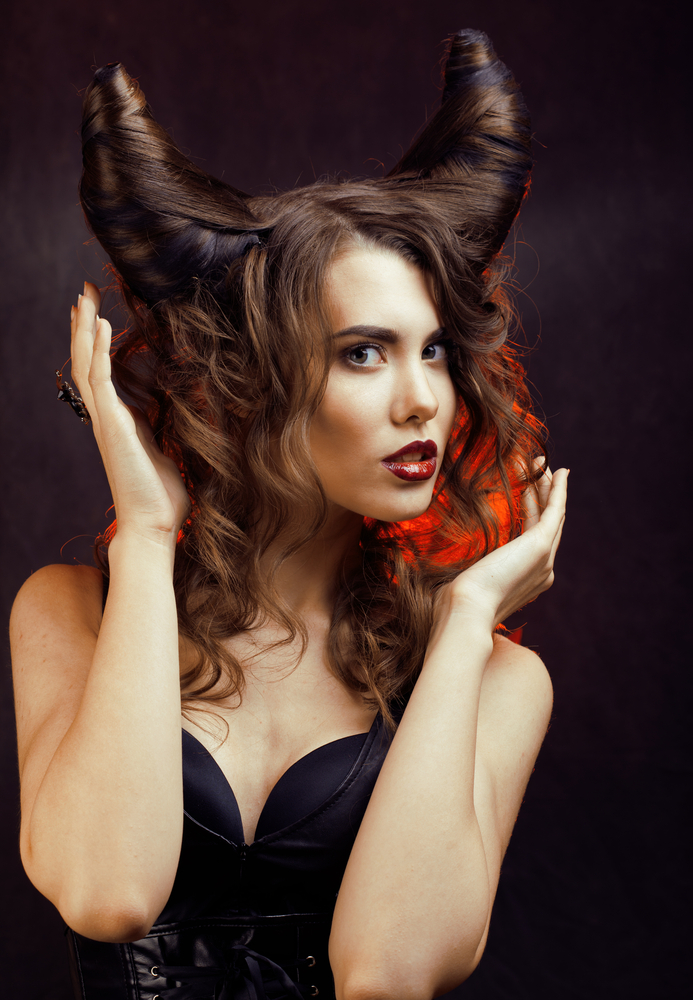 Lady with hair put up as devil horns