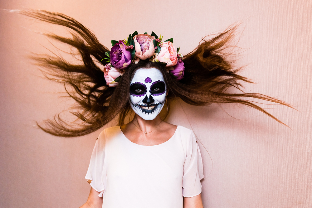 Girl with flowy hair and skeleton makeup