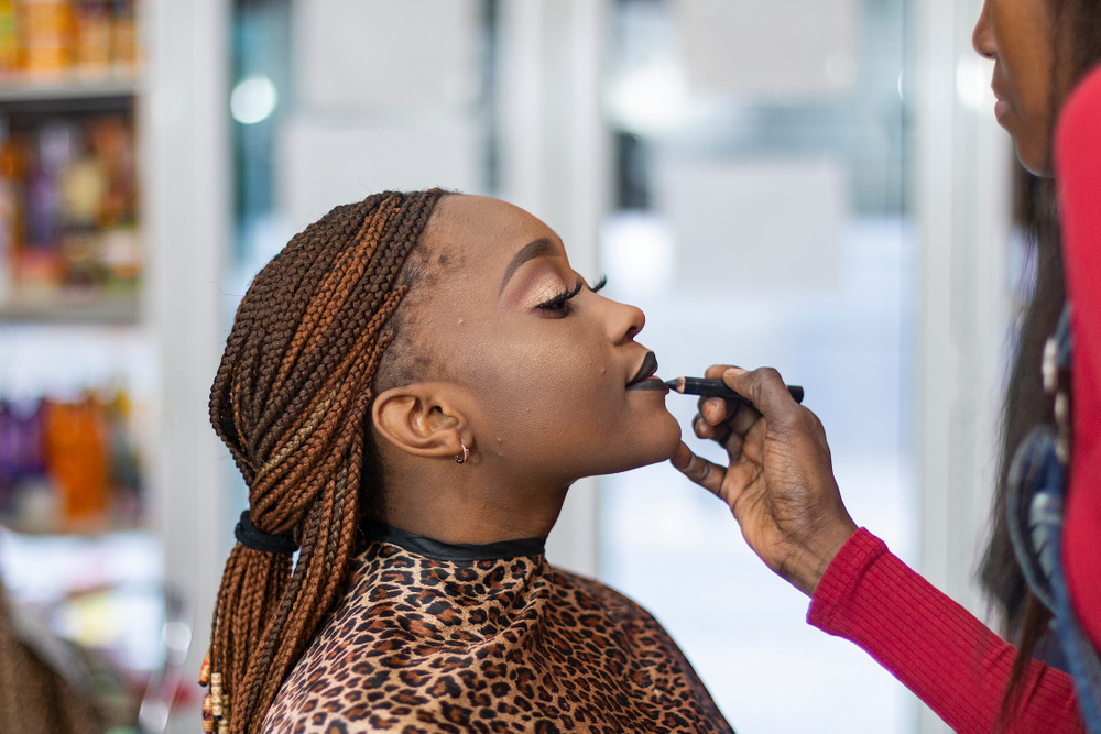 woman getting her makeup done at a salon