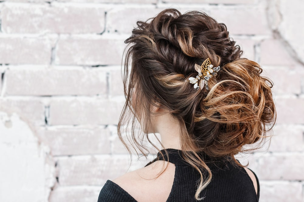 A woman with a braid and bun updo.