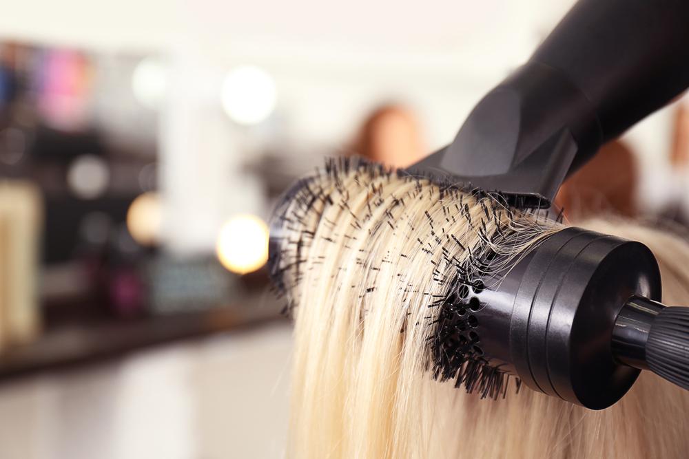 Blond hair being hair dried