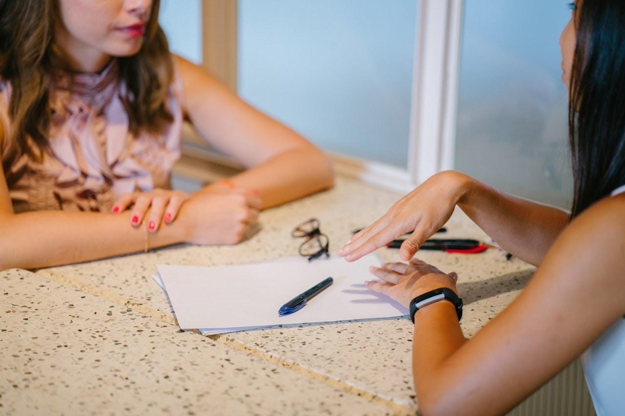 two women talking across a table having a meeting