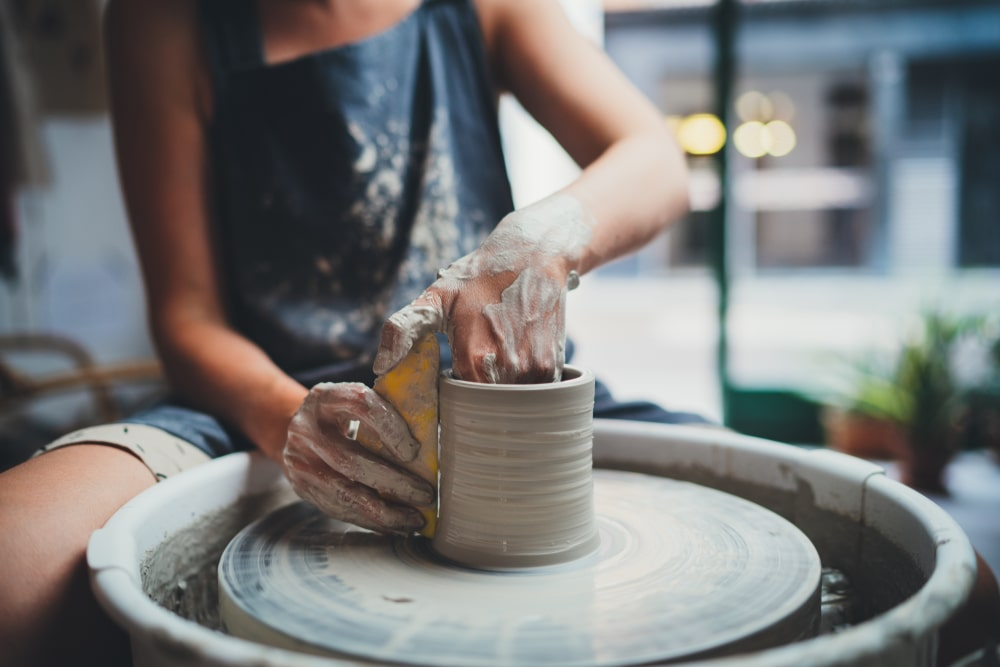 woman doing at a pottery wheel
